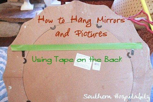 Hate hanging pictures or mirrors with 2 hooks?  Easy method for hanging pics with tape. Wait til you see how totally easy this is!