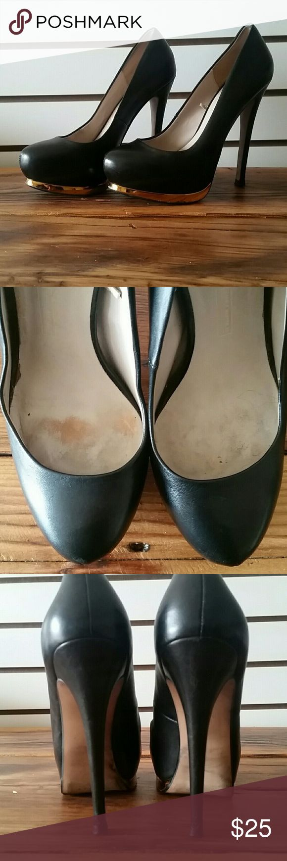 Zara Black and Gold Pump Worn, but still in great condition! Great for a fancy evening. Wear shown in pictures, as well as some very mild scratching on the front gold reflective part of the shoe. Share, like, and leave questions in the comments! Zara Shoes Heels