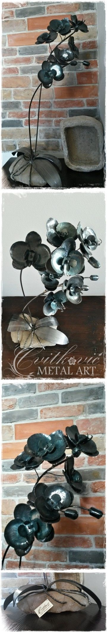 Wrought Orchid Laguna ( blue turquoise color achieved through heating the metal). Placed on wild white marble from the island of Hvar. ( #ForgedOrchid , #marble , #Flower , #Orchid , #IronOrchid )