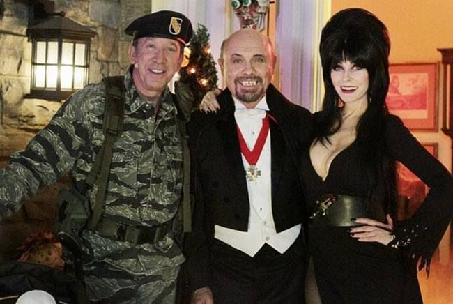 "ABC's Last Man Standing went full steam ahead in their Halloween episode, with a street full of trick-or-treaters, not to mention a visit from the ""real"" Elvira (pictured with Tim Allen and Hector Elizando)."