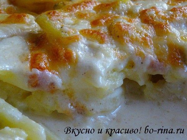 Для тех, кому не хочется мяса!.Вкусный картофель запечённый со сливками и сыром..Ингредиенты:.1 кг картофеля.200 мл сливок.200 мл молока.соль, перец.3 зубчика чеснок.20-30 гр сливочного масла.100-150 гр тёртого сыра..1. Картофель очистить...