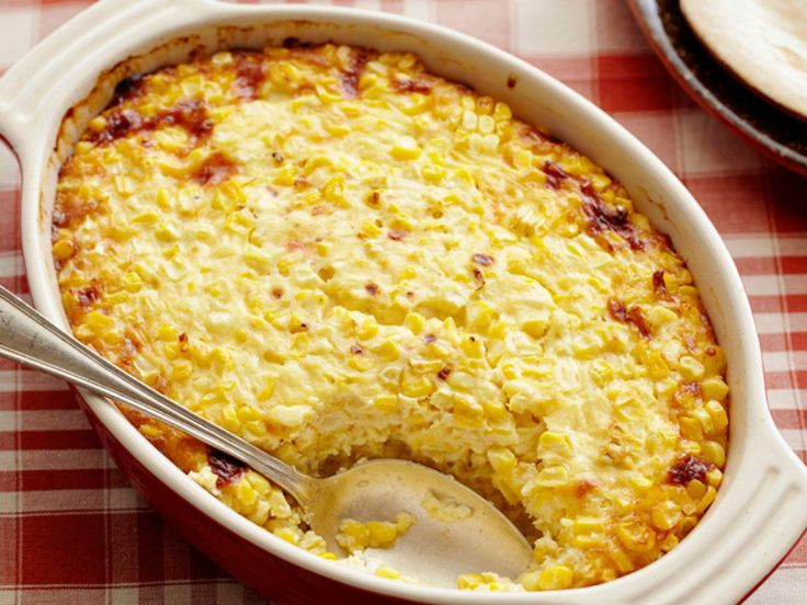 Sweet Corn Pudding : When scraping the kernels away from the cob to use in their corn pudding, the Neelys reserve the milky runoff to later incorporate as a natural thickener, along with the milk, heavy cream and cheddar cheese.