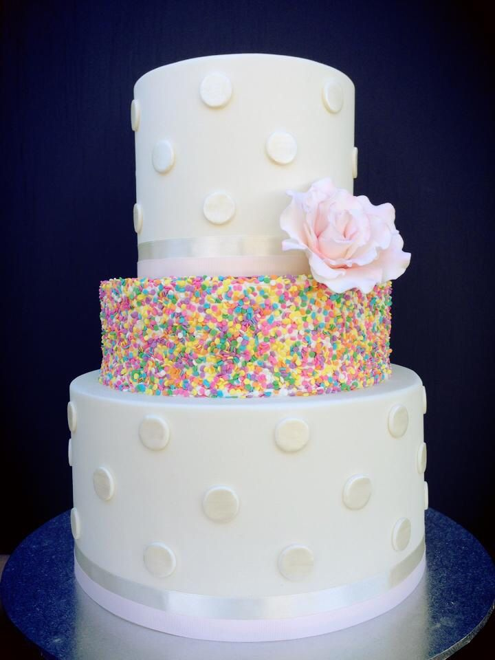 Confetti three tiered cake with fondant flower detailing
