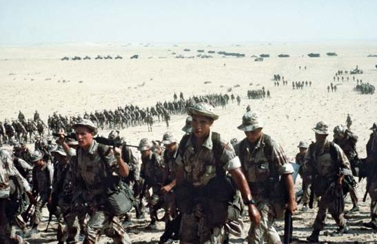 """Operation Desert Storm 1990: """"The Iraqi invasion of Kuwait in August 1990 led to the largest movement of Marine forces since World War II. Between August 1990 and January 1991, 24 infantry battalions, 40 squadrons (more than 92,000 Marines) deployed to the Persian Gulf as part of Operation Desert Shield. The air campaign of Operation Desert Storm began Jan. 16, 1991, followed by the main overland attack Feb. 24 when the 1st and 2nd Marine Divisions breached the Iraqi defense lines and…"""