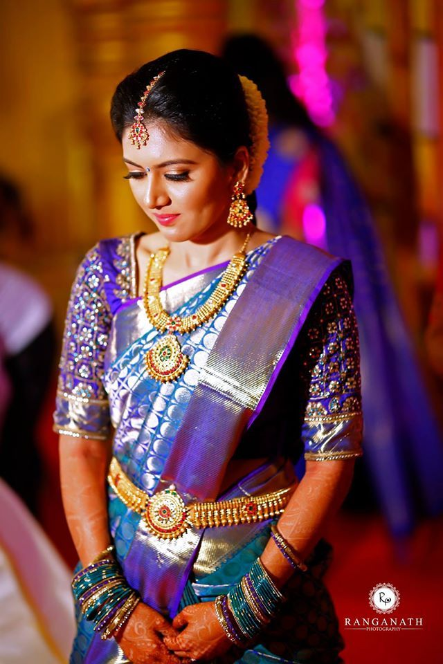 South Indian bride. Gold Indian bridal jewelry.Temple jewelry. Jhumkis. Blue silk kanchipuram sari.Braid with fresh jasmine flowers. Tamil bride. Telugu bride. Kannada bride. Hindu bride. Malayalee bride.Kerala bride.South Indian wedding.