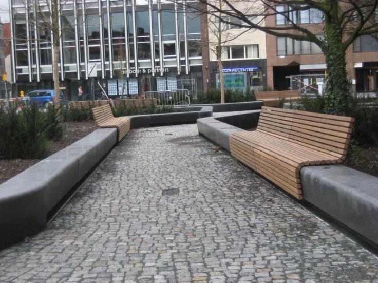 LANDLAB studio voor landschapsarchitectuur. wood bench wrapping around concrete wall