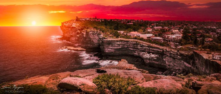 The gap in sunset - The gap is located in North of Sydney, Australia that is one of the most stunning and attractive point for tourists. I was there in sunset a few days ago and waiting for the moment when the sun was emerging from the ocean. The whole area was redden by vivid light from the sun, creating unforgettable moment ....