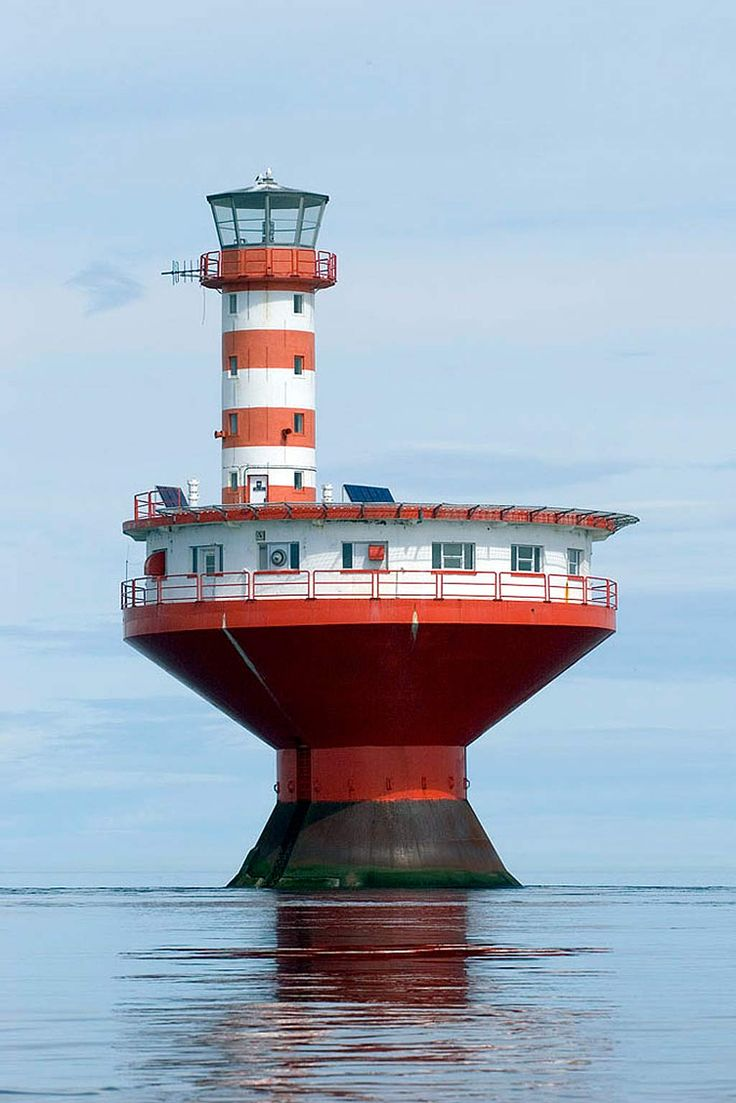 Haut-fond Prince Light - one of the most dangerous shoals in the St. Lawrence River is found near Tadoussac, Quebec, off mouth of Saguenay River.  The cylindrical tower with red and white horizontal stripes, on top of circular dwelling on caisson, resembles a child's top. Built in 1964, the light replaces the Prince Shoal Lightship station, that had been established in 1902. The lighthouse warns passing vessels of the undersea hazard in the area.