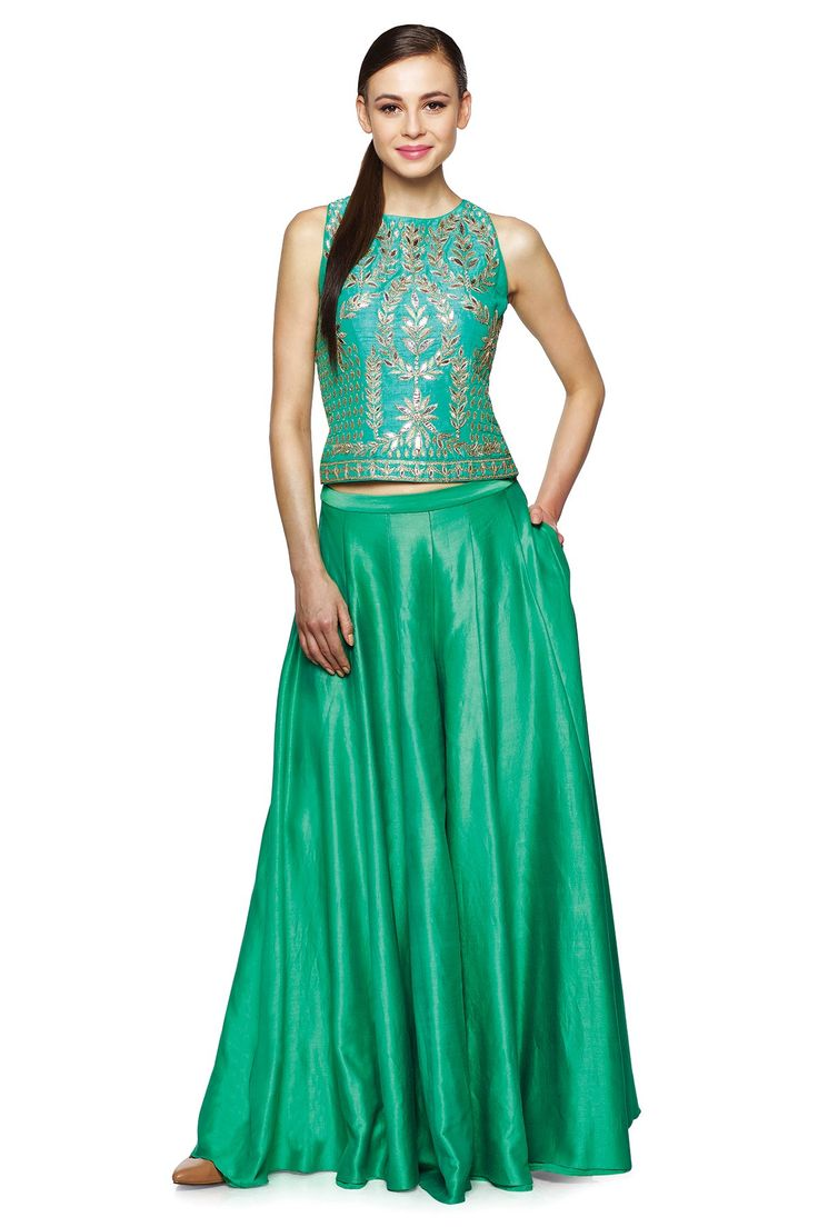 <p>Presenting a beautiful fusion of contemporary and tradition with this crop top and cascading Sharara. Pair it with studded earrings and a ring to take everyone's breath away.</p>$44,000.00