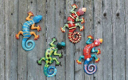 "Set of 4 Gecko Metal Painted Wall Hangings Southwestern Art by DEI. $41.99. Hand painted metal. 4 unique designs (you get one of each). Each features 2 metal hooks for hanging (hardware not included). Each gecko measures approximately 13"" L x 7"" W. Set of 4 geckos. Spice up your southwestern decor with some colorful gecko wall art. These four fine fellows looks great anywhere you need a bold splash of color.  Made of metal and hand painted, these works of art can ..."