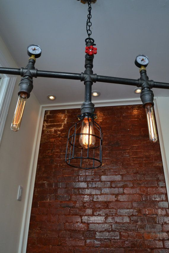 Hanging Multiple Pendant Industrial Pipe Light with Edison Bulbs. Steampunk Decor We Love at Design Connection, Inc. | Kansas City Interior Design http://designconnectioninc.com/blog/ #Steampunk #InteriorDesign