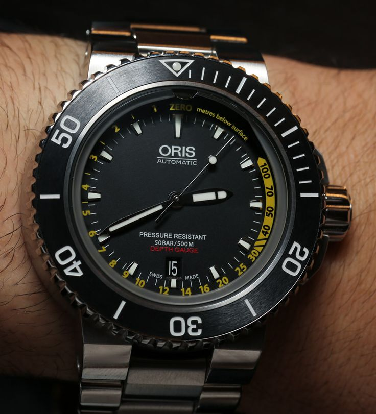 "Oris Aquis Depth Gauge Watch Hands-On - Read about it and see the photos on aBlogtoWatch.com ""Last year one of the most talked about dive watches was Oris' surprise hit, the Aquis Depth Gauge. I don't think Oris realized what a hit it would be, and even we were surprised by how many people professed their desire for this watch. Oris is well-known as a producer of well-made, extremely durable, and rugged looking mechanical Swiss dive watches..."""