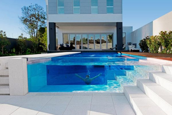 Australia's Out From The Blue (OFTB) designed this incredible pool with a transparent wall that follows the treads of the steps down into the pool.