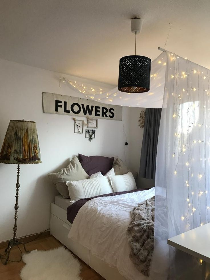 Beautiful four-poster bed with fairy lights. #WGroom ...