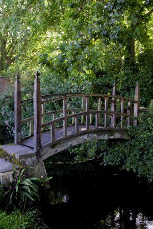 Wooden footbridge at Barrington Court, Somerset.