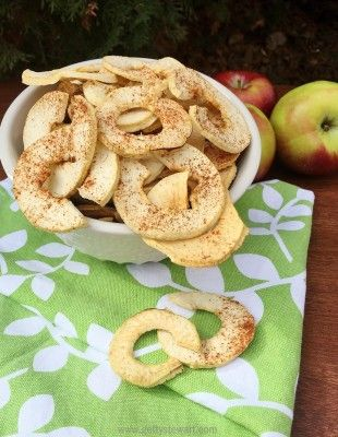 Dried apple rings with cinnamon. Such a yummy snack for kids and adults alike.  You can make these in the oven or a dehydrator, this website has both techniques and good tips on how to know when they're dry enough and what to do if they're too dry - unless  of course you want apple chips and then there is no such thing as too dry! #apples #driedapples #applerings