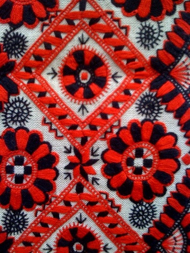 Russian traditional embroidery on linen. Geometric pattern in red and black colours. #folk #textile