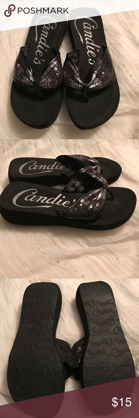 Brand NWOT Candies flip flops sequins 7.5 Brand NWOT Candies flip flops sequins 7.5.. Black with silver sequences .. gorgeous for spring-summer..show off that pedi!! One spot on bottom back of one pair- from traveling in a hurry and a flat iron (hair straightener) was not completely cool and fell out of its cooling sleeve.you can barely see on bottom of edge of shoe and when standing you can't see from back-mostly on bottom and one small line .more pics just ask - price reflects.. Smoke free…