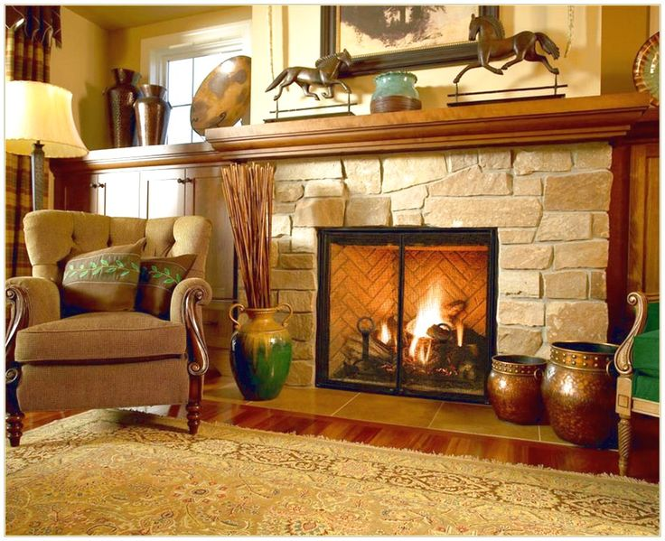 GET AN ATTRACTIVE LOOK WITH FIREPLACE MANTEL WITH ORNATE FIREPLACE WHICH HAS A BROWN HORSE STATUE