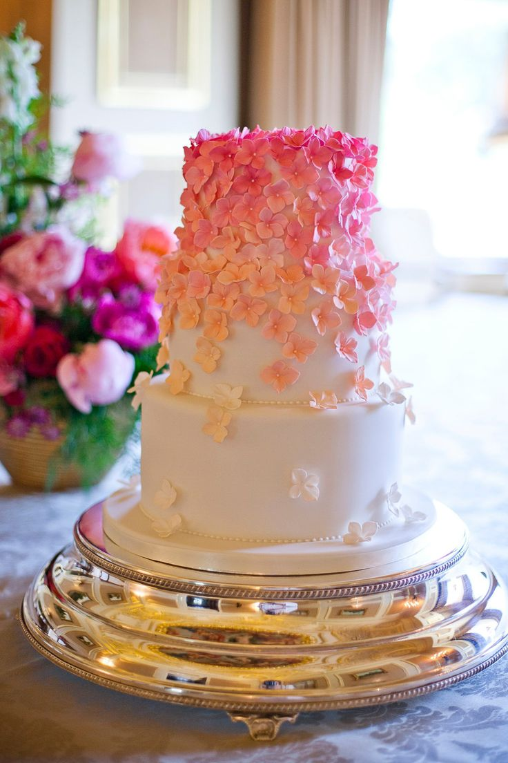 Pink ombre wedding cake by Zoe Clark Cakes.  International black tie wedding at Fetcham Park in Surrey.  Photography by Emma Sekhon.