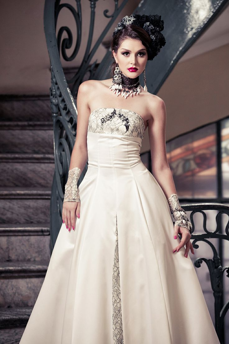 Strapless floor-length ball gown with fitted bodice embellishedwith beautiful black&white details, classic split. See more at:http://www.weddinginspirasi.com/2013/12/05/meera-meera-fall-2013-wedding-dresses/