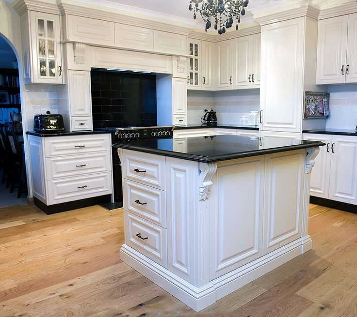Such a great design - love the mantlepeice, love the drawers in the island bench ... and magnificent handles too ..
