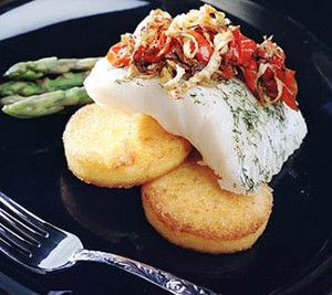 Oven baked sea bass with fennel and tomatoes.The aniseed flavour of the fennel beautifully complements the subtle taste of the baked sea bass.This dish is fished with roasted tomatoes and capers,and needs nothing more than some roasted potatoes to complete the meal.