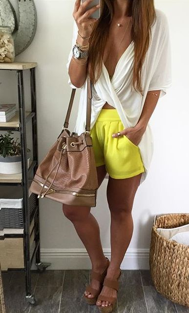 summer outfit. white twisted tee. yellow shorts. brown wedge sandals.