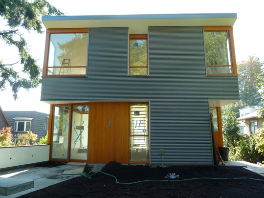 Exterior finishes - corrugeted and wood panelling