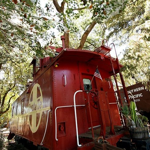 Featherbed Railroad Caboose Bed & Breakfast | Of all the hotels you must add to your bucket list, California's Featherbed Railroad Caboose is the quirkiest. Head up North to Clear Lake to take a break from reality and step into a fantasy-land aboard one of the hotel's nine themed caboose guestrooms — in case you missed it, the hotel is a vintage train!
