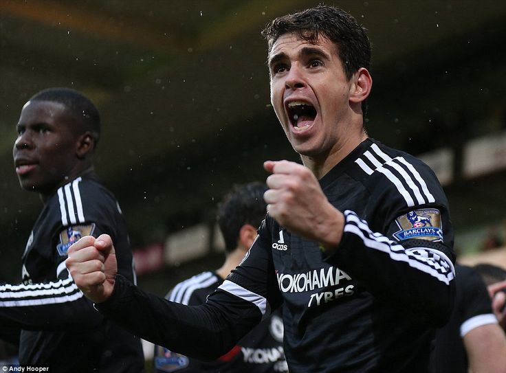 Oscar celebrates in front of the Chelsea supporters after his Brazil compatriot Willian f...