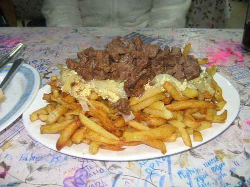 "Chorrillana....(It is one of the most typical dishes of junk food in Valparaiso, consists of meat, eggs scrambled with onions, French fries, sausages. As it is a rich dish, usually (at least in Valpo) are served for three or four people. It is said that the Chorrillana born in the famous restaurant ""Jota Cruz"" in Valparaiso)."
