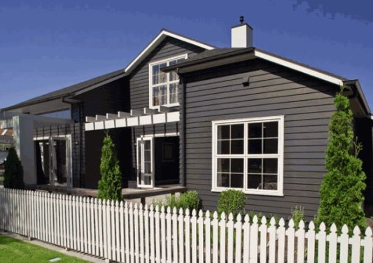Dark Charcoal with white trims exterior colour scheme, The dark coloured house really makes the green foliage stand out!