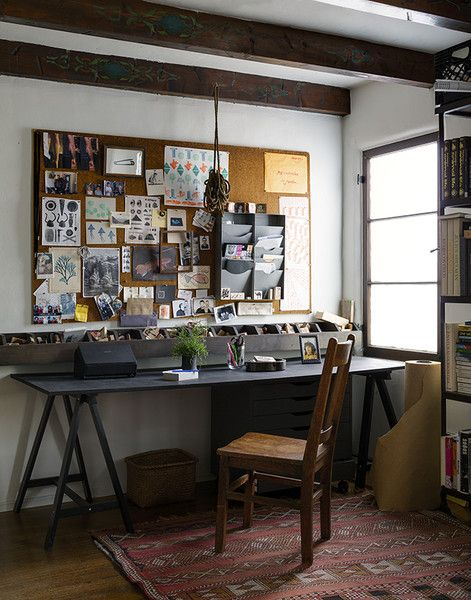 Contemporary Rustic Work Space: Exposed ceiling beams hanging over window lit workspace..