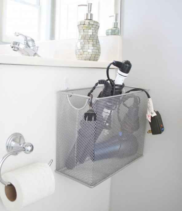 A magazine rack can be the solution to all your tangled hot tool problems.