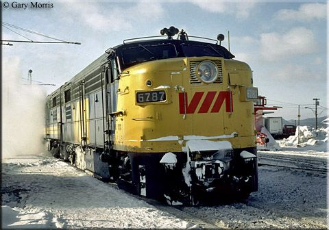 "VIA FPA-4 #6787 has the eastbound ""Ocean"" at Campbellton, New Brunswick on a cold day in December of 1980."