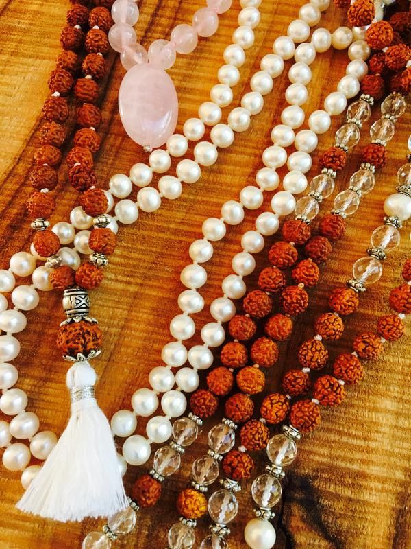 A Mala Necklace is like a rosary of the Hindu and Buddhist tradition that is used for prayer and meditation. It is worn around the neck and is believed to prote