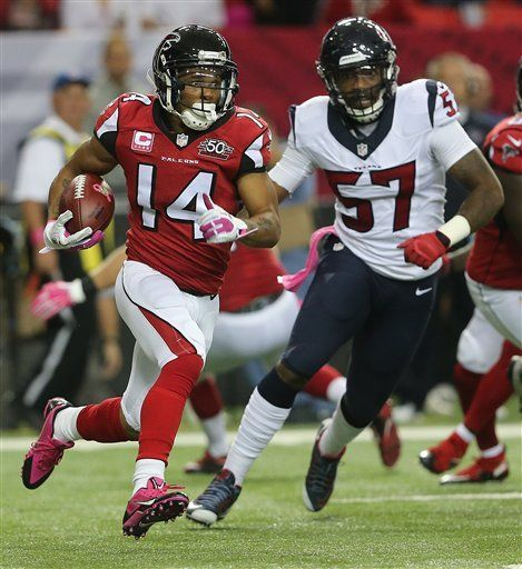 Atlanta Falcons wide receiver Eric Weems (14) runs after the kick off against Houston Texans inside linebacker Justin Tuggle (57) during the first half of an NFL football game, Sunday, Oct. 4, 2015, in Atlanta. (AP Photo/John Bazemore) -   Texans Falcons Football