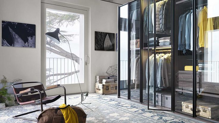 The modern bedroom focuses on the walk-in closet: an exposed closed and a number of different retro-inspired accessories.
