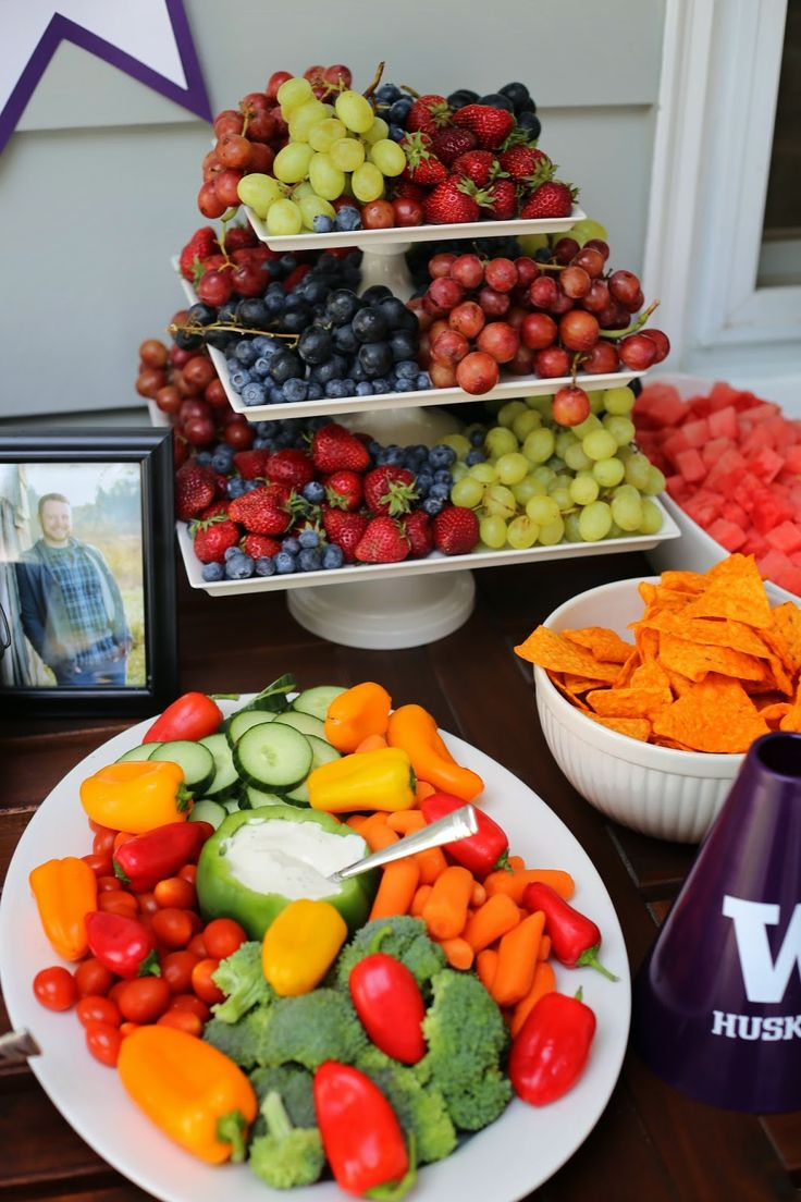 UW Graduation party food table. purple and gold party.  Use a pepper to serve the dip and a cake stand for the fruit