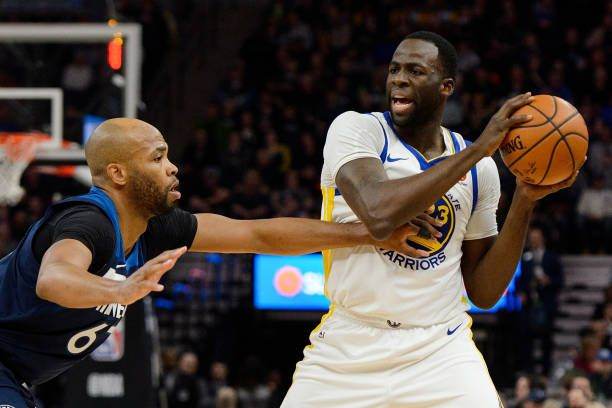Draymond Green of the Golden State Warriors has the ball against Taj Gibson of the Minnesota Timberwolves during the game on March 11 2018 at the...