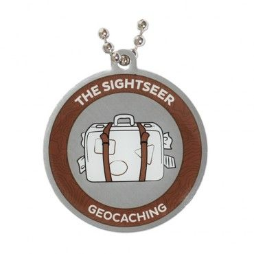 7SofA Travel Tag: The Sightseer $5.50 USD  Are you your own Travel Bug®? Is your profile page plastered with photos of you exploring the 7 Wonders of the World? Is it geocaching instead of a guidebook that shows you all the locals' favorite spots?  If this sounds like you or someone you know, celebrate with this cool Sightseer tag! The tag comes with a chain for hitchhiking!  Find a Multi-Cache to earn the Sightseer souvenir. Size: 1.5 inches (3.8cm) in diameter