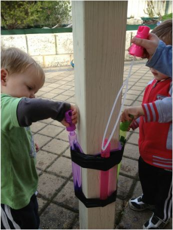 Bubble mix doesn't last long in the hands of a child... Create a bubble station to provide a solution. Genius!!! Gotta do this on the balcony!