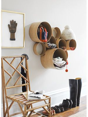 "Really cute to put blankets in or Other kid stuff!!!  Cardboard tubes for chic wall storage. At Home Depot a 12""X48"" cardboard concrete forming tube is about $11. However, it has branding prints all over it. So, you'd have to modify this DIY craft by adding wallpaper or fabric, something to conceal the brand"