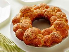Quick Herb and Cheese Monkey Bread : Prepared biscuit dough is the base for this pull-apart loaf, which is formed by rolling the dough in olive oil and herbs before piling in a bundt pan, which helps turn the loaf crispy and golden brown. Our tasters called them the Southern version of pizza-shop garlic knots.