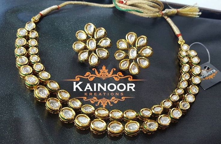 Beautifully simple kundan necklace and studs set by Kainoor Kreations.