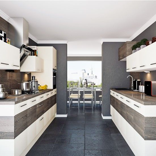 Contemporary streamlined galley kitchen | Simplify and open up a space by employing large base cabinets with linear wall units above | housetohome.co.uk