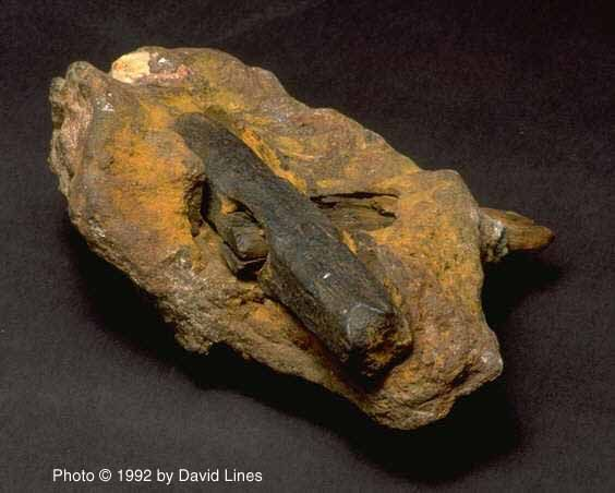 The 10 most amazing unexplained artifacts.  This picture is a 500 million year old hammer!