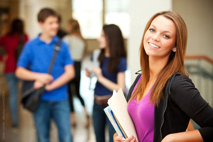 High School: Cute Student Smiles to Camera by sjlocke | Stocksy United