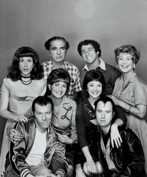 1976 cast photo from the television program Laverne and Shirley. Standing, from left: Carole Ita White (Rosie Greenbaum), Phil Foster (Frank DeFazio), Eddie Mekka (Carmine Ragusa), Betty Garrett (Edna Babish). Middle row, standing: Penny Marshall (Laverne DeFazio), Cindy Williams (Shirley Feeney). Seated : Michael McKean (Lenny), David Lander (Squiggy).